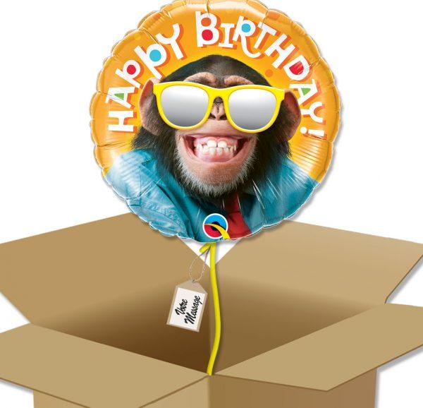 Ballon anniversaire chimpanzé dans sa boîte.