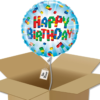 Ballon anniversaire Lego dans sa boîte.