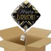 Ballon anniversaire noir et doré dans sa boîte.