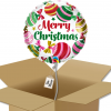 """Ballon rond écriture """"Merry Christmas"""" boule de noël rose et verte dans sa boîte."""